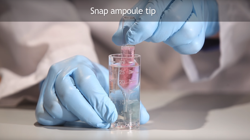 Snap the tip of the ampoule on the bottom and side of the sample cup